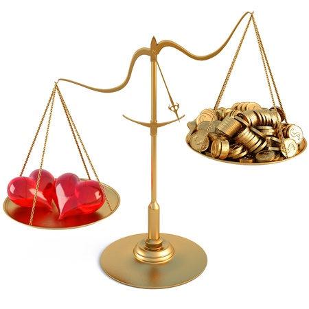 pile of coins: two loving hearts outweigh the pile of gold coins on the scale. isolated on white.