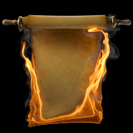 burning paper: ancient antique scroll in the fire. isolated on black.
