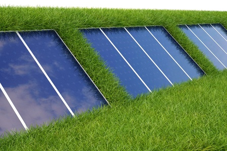 electric cell: solar panel on the green grass. Stock Photo
