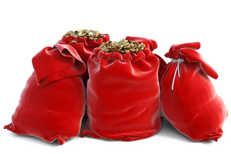 red bags full of golden coins. isolated on white. photo