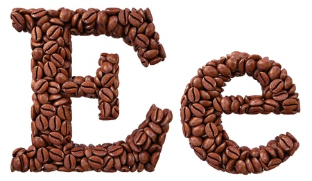 Alphabet from coffee beans. isolated on white. photo