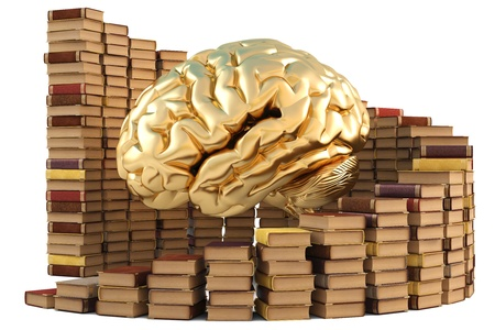 heap up: golden brain with stacks of books. isolated on white.. isolated on white.