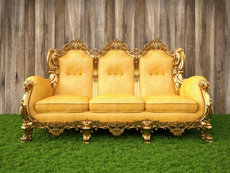 gold sofa in a room with a floor of grass. photo