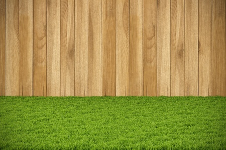 wooden wall and floor from the green grass. Stock Photo