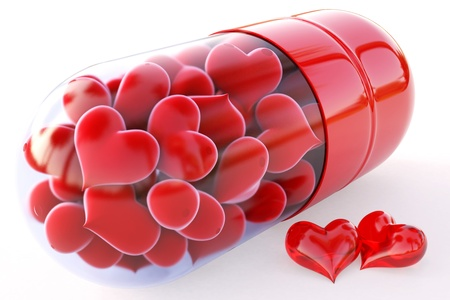 doctor tablet: red hearts inside the red capsule. isolated on white.