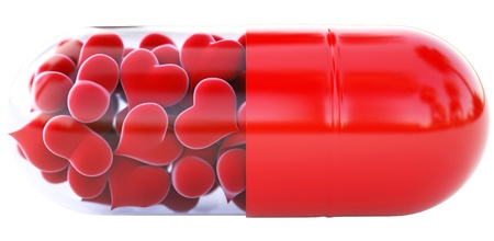 red hearts inside the red capsule. isolated on white. photo