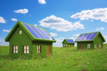 houses from the grass with solar panels on the roof. photo