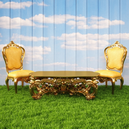 wooden wall with painted sky and floor from the green grass. on the grass stands a luxury chairs and table. photo