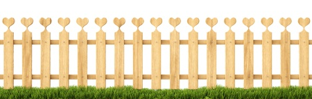 wooden fence in the grass. Isolated on white. photo