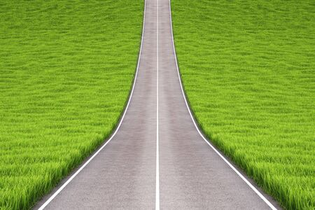 over the hill: asphalt road in field with green grass.