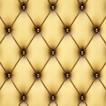 leather armchair: luxurious yellow leather with gold buttons.
