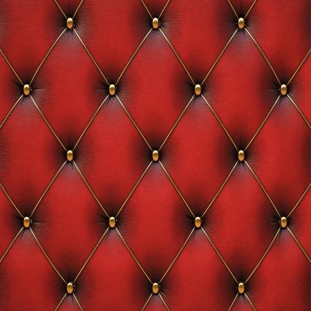 金ボタンの付いた豪華な赤い革。 写真素材