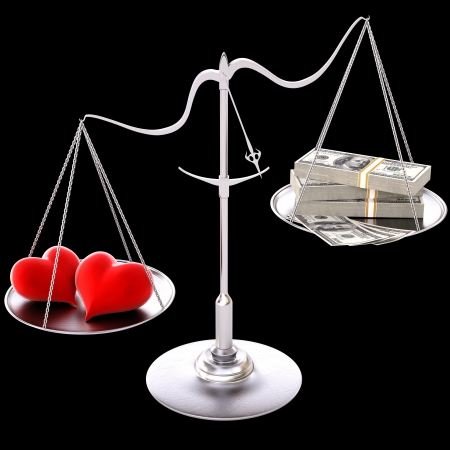 two loving hearts outweigh the money. Isolated on black. Stock Photo