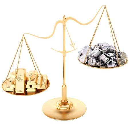 balance scale: gold bullion heavier than silver coins. Isolated on white.