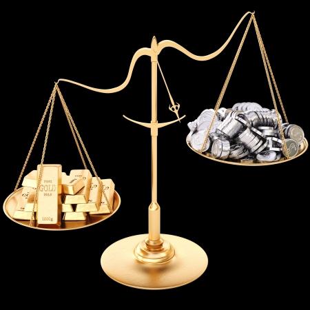 gold bullion heavier than silver coins. Isolated on black.