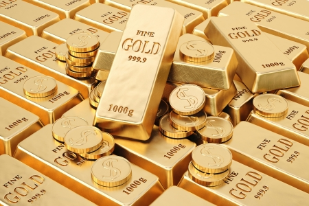 ingot: gold bars and gold coins. Stock Photo
