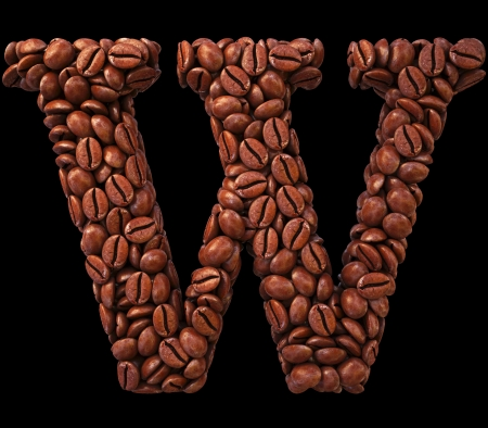 Alphabet W from coffee beans. isolated on black. photo