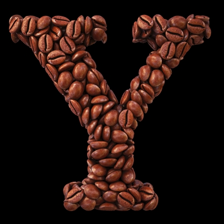 Alphabet Y from coffee beans. isolated on black. photo