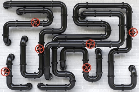 Black oil pipes on a brick wall. photo
