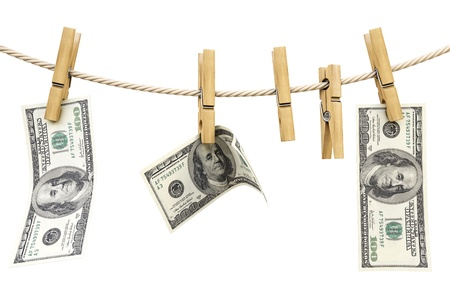 dollar bill is hanging on a rope with wooden clothespin. isolated on white. Stock Photo