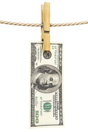 dollar bill is hanging on a rope with wooden clothespin. isolated on white. photo
