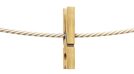 clothespin and rope: wooden clothespin on a rope. Isolated on white. Stock Photo