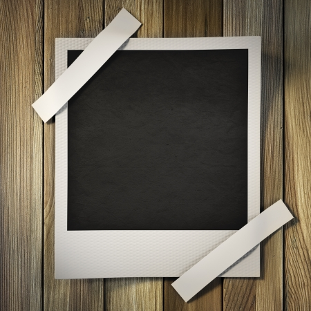 photo frame on a wooden background. Stock Photo - 22135560