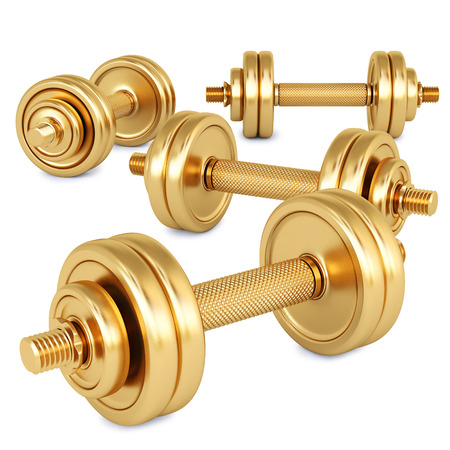 Golden dumbbell. Isolated on white. photo
