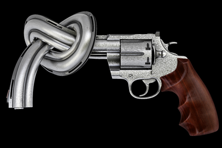 pacifism: gun tied in a knot. Isolated on black. Stock Photo