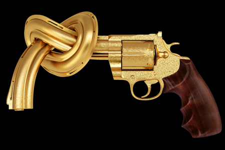 golden gun tied in a knot. Isolated on black. photo