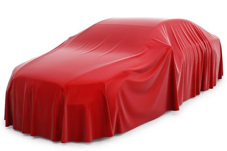 sorpresa: Presentación del nuevo coche. Coche cubierto con un paño rojo. Foto de archivo