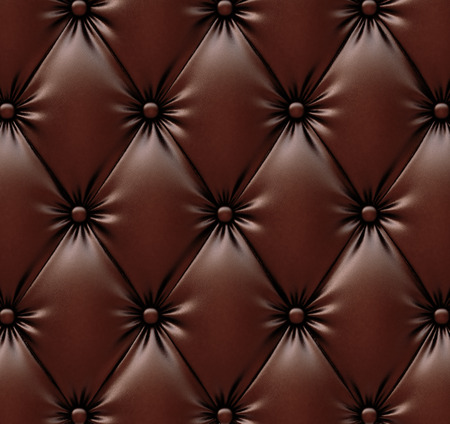 luxurious texture of chocolate-colored leather upholstery. photo