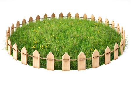 round eiland met een grasveld omsloten door een houten hek. geïsoleerd op een witte achtergrond. Stockfoto