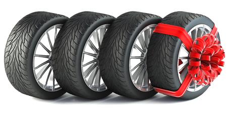 ruban noir: pneus enveloppés dans un ruban de cadeau rouge avec un arc. isolé sur fond blanc.