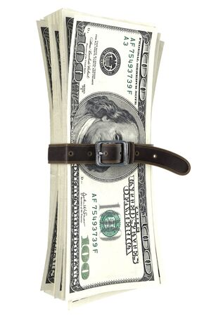 leather belt: dollar bills squeezed together by leather belt. isolated on white background. Stock Photo