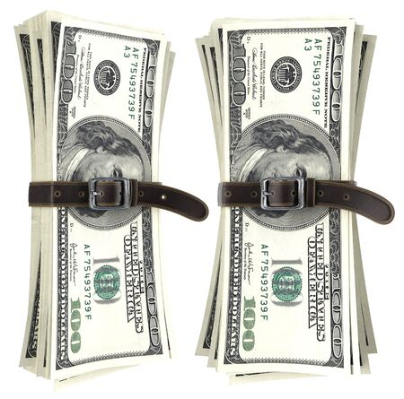 tightening: dollar bills squeezed together by leather belt. isolated on white background. Stock Photo