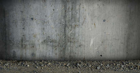 Concrete wall texture with gravel floor Stock Photo
