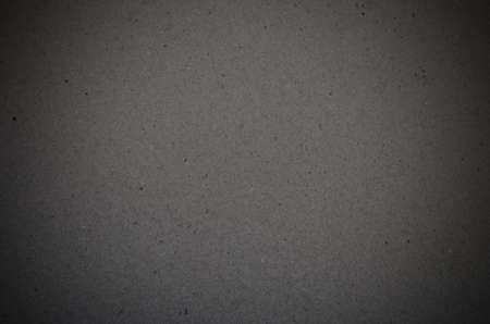 Dark gray grungy background texture and vignetting