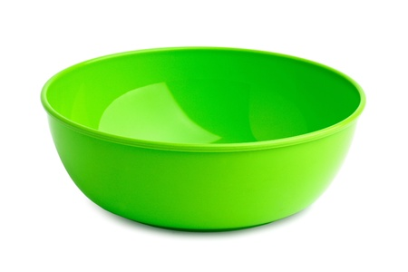 factitious: Beautiful bright green plastic plate on a white background