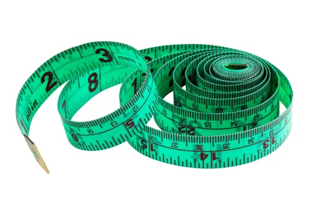 meticulous: Folded green measuring tape on white background
