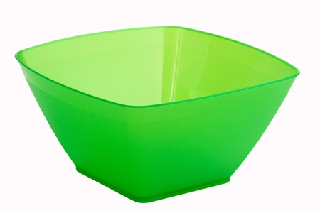 An empty green plastic plate on a white background photo