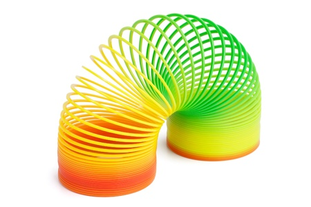 Beautiful colorful plastic spring toy on a white background Standard-Bild