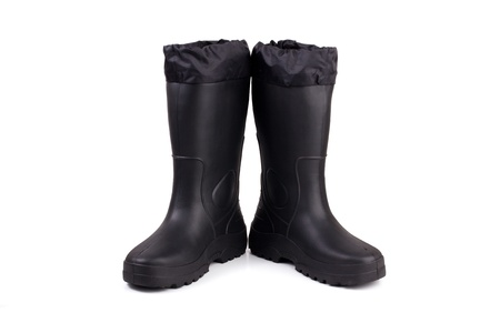 A pair of black rubber boots on a white background photo