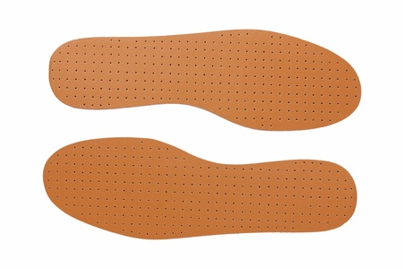 breathable: Brown leather shoe insoles on a white background Stock Photo