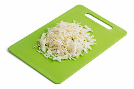Shredded cabbage on a cutting board on a white background Stock Photo