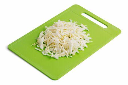 Shredded cabbage on a cutting board on a white background 版權商用圖片
