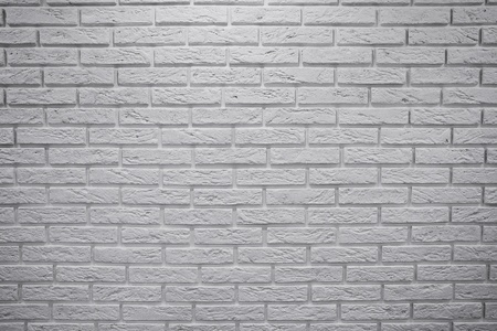 Obstacle in the form of a vertically standing brick wall white Stock Photo