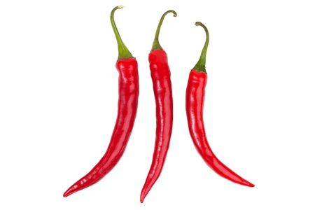 Three bright red chili peppers on white background Stock Photo