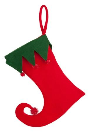 Recorte de un calcetín de Navidad con una nariz doblada sobre un fondo blanco