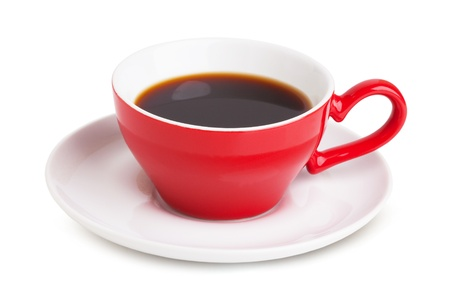 Red cup with instant coffee on a white saucer on a white background